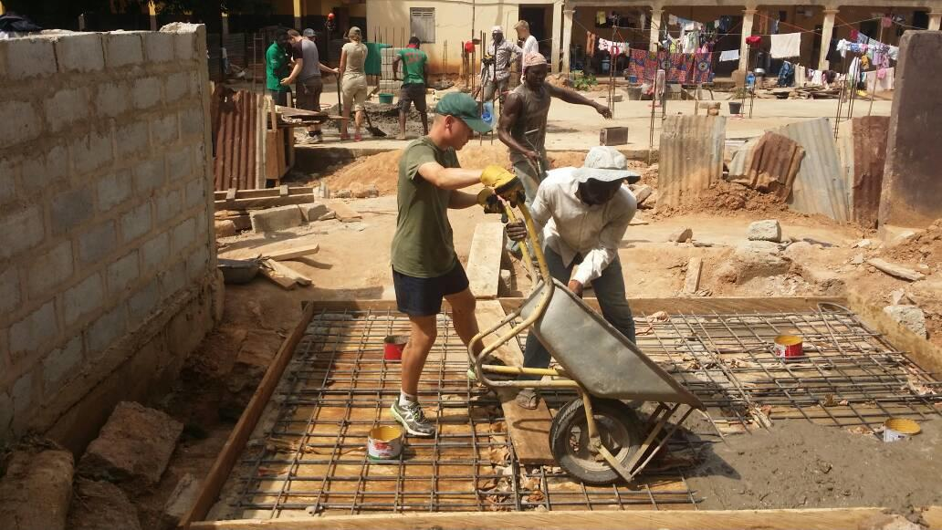 A volunteer is pictured laying the foundations for a toilet block as part of his building volunteer work in Ghana.